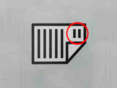 Symbol am Drucker - Papier mit Kopfzeile nach rechts einlegen